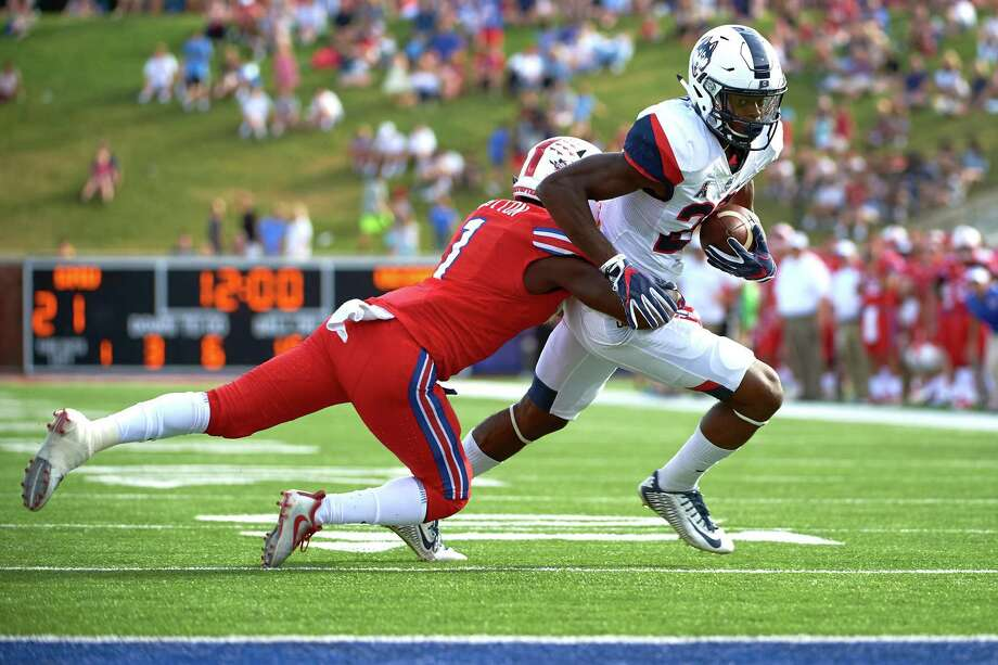 UConn freshman receiver Keyion Dixon, right, has 13 catches for 159 yards and one touchdown this season. Photo: Cooper Neill / Getty Images / 2017 Getty Images