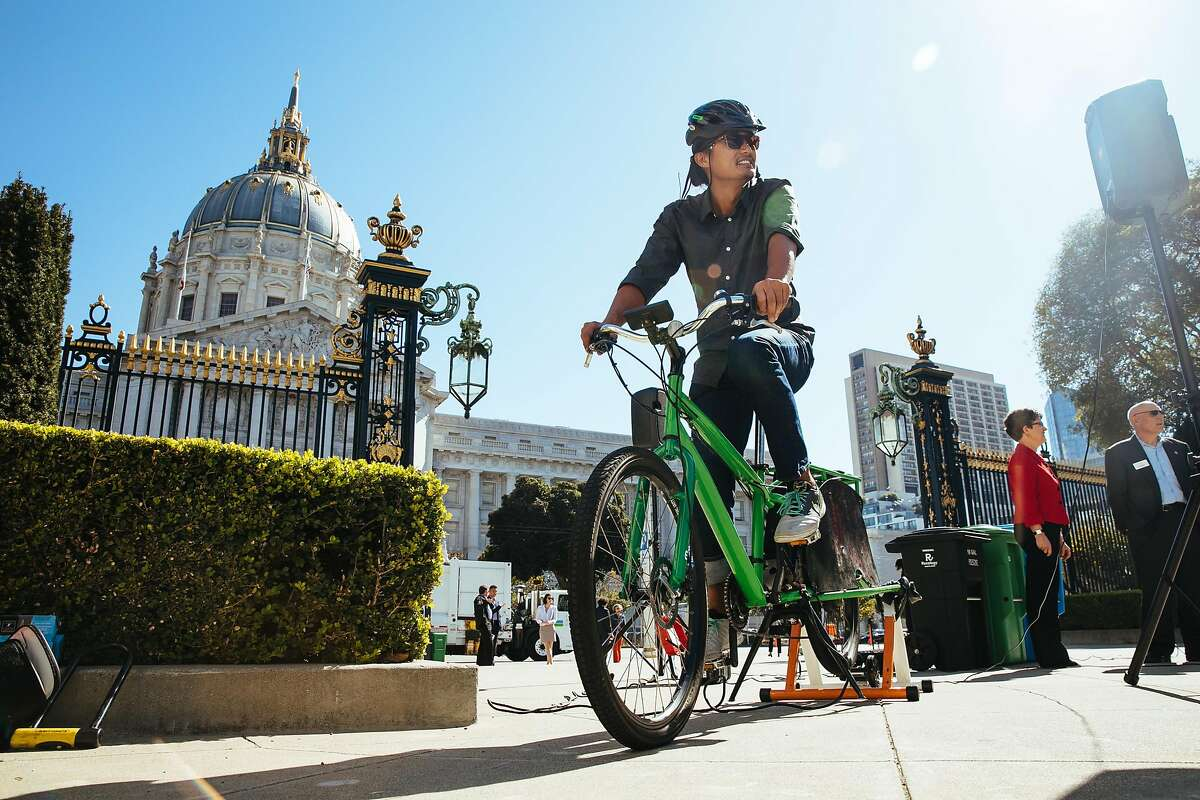 Brian Reyes of Department of Environment powers the speakers and microphones through a bike generator during San Francisco Department of Environment and Ecology announcement event in San Francisco, Calif. Thursday, October 5, 2017.