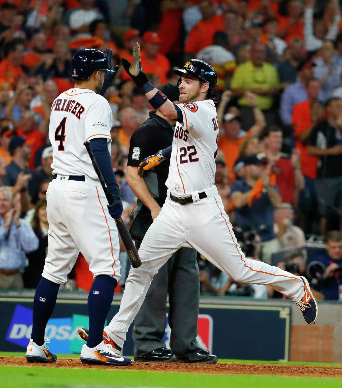 Houston Astros right fielder Josh Reddick comes home during the sixth inning of Game 1 of the ALDS at Minute Maid Park on Tuesday, Oct. 3, 2017, in Houston.
