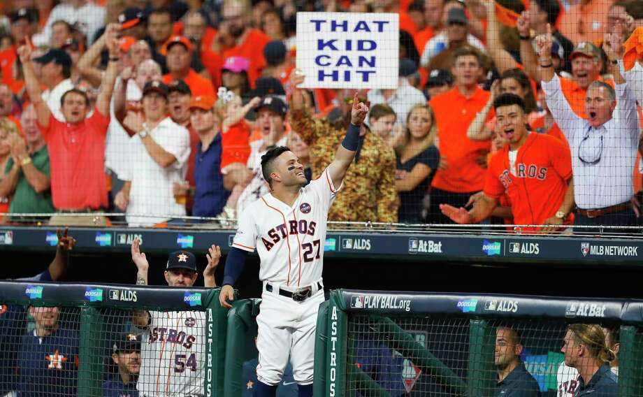 PHOTOS: A look at the Astros' 8-2 win over the Red SoxHouston Astros second baseman Jose Altuve comes back out of the dugout to celebrate his third solo home run of the game during the seventh inning of Game 1 of the ALDS at Minute Maid Park on Thursday, Oct. 5, 2017, in Houston. Altuve hit home runs in the first, fifth and seventh innings to become just the 10th player to hit three post season home runs in one game. Photo: Brett Coomer / © 2017 Houston Chronicle