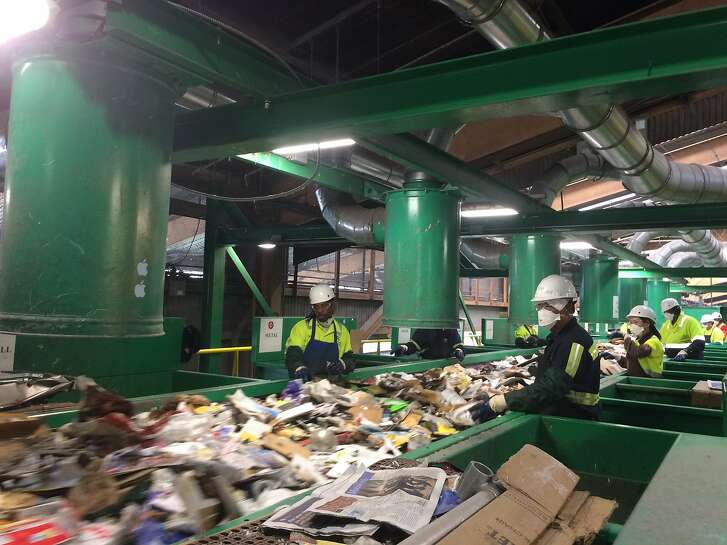 Columnist Caille Millner takes a tour of Recology's recycling plant at Pier 96 in San Francisco. Here, employees sort recycling that runs on a complex conveyer belt.