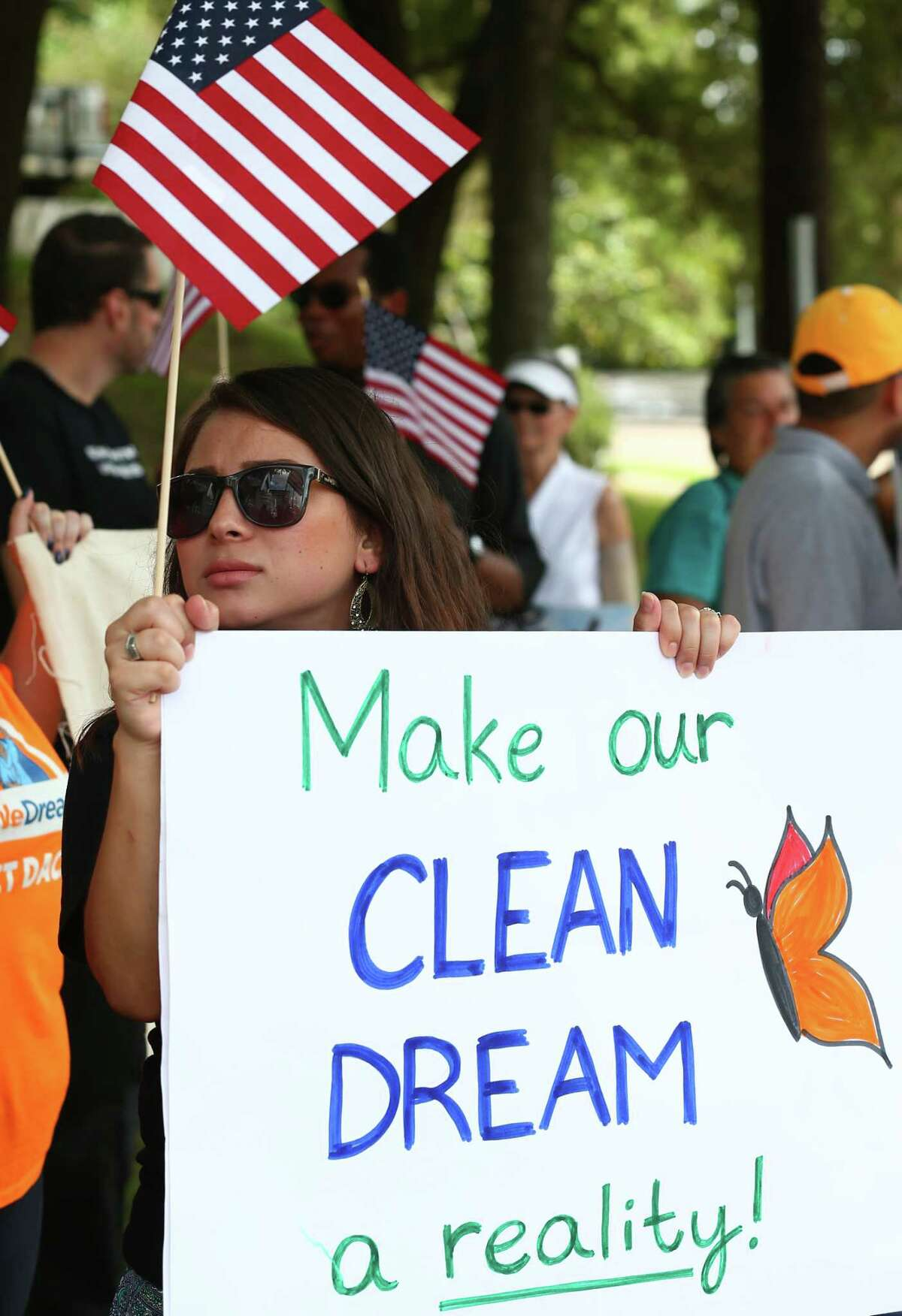People with United We Dream Houston rally outside Senator John Cornyn's office to voice their support for a