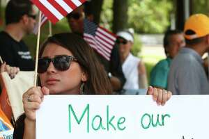 "People with United We Dream Houston rally outside Senator John Cornyn's office to voice their support for a ""Dream Act"" without dangerous enforcement add-ons Thursday, Oct. 5, 2017, in Houston."