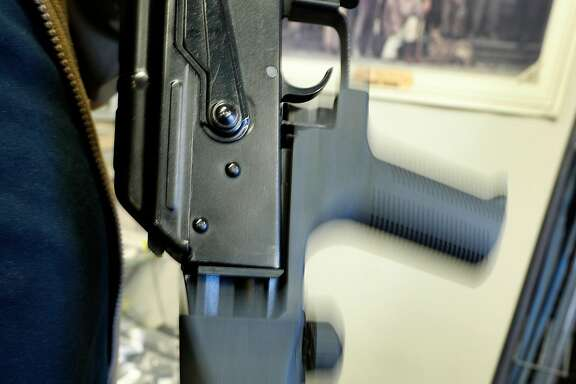 SALT LAKE CITY, UT - OCTOBER 5: The motion of a bump stock device as shown here on a AK-47 semi-automatic rifle to increase the firing speed, making it similar to a fully automatic rifle, at a gun store on October 5, 2017 in Salt Lake City, Utah. Congress is talking about banning this device after it was reported to of been used in the Las Vegas shootings on October 1, 2017.  (Photo by George Frey/Getty Images)