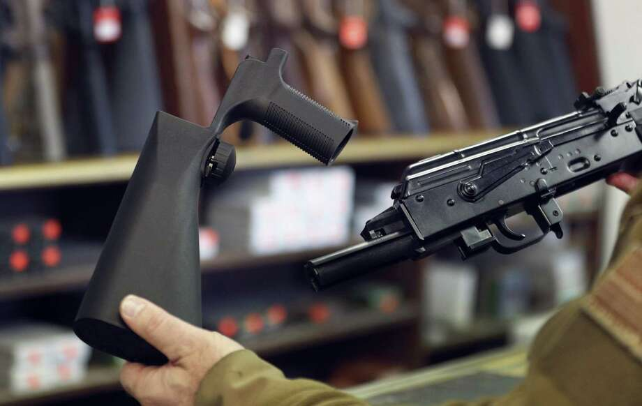 A bump stock device (left), that fits on a semi-automatic rifle to increase the firing speed, making it similar to a fully automatic rifle, is shown next to a AK-47 semi-automatic rifle (right), at a gun store on October 5, 2017 in Salt Lake City, Utah. Congress is talking about banning this device after it was reported to of been used in the Las Vegas shootings on October 1, 2017. Photo: George Frey / Getty Images / 2017 Getty Images