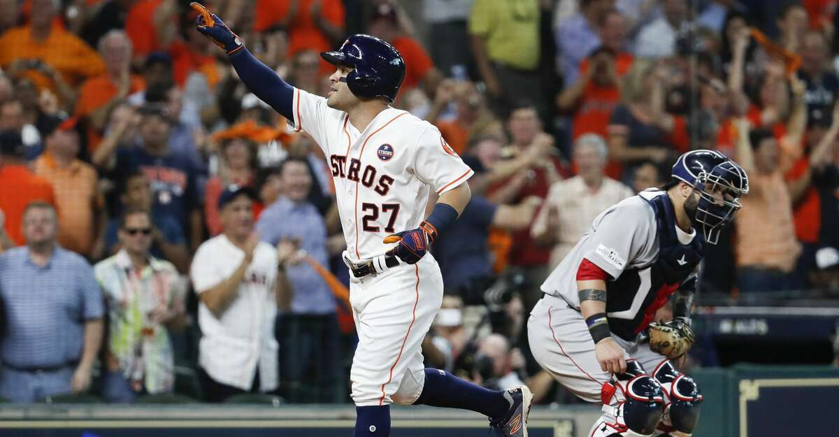 Houston Astros second baseman Jose Altuve celebrates his third solo home run during the seventh inning of Game 1 of the ALDS at Minute Maid Park on Thursday, Oct. 5, 2017, in Houston. With home runs in the first, fifth and seventh innings, Altuve became just the 10th player in history to hit three home runs in a single post season game. ( Karen Warren / Houston Chronicle )