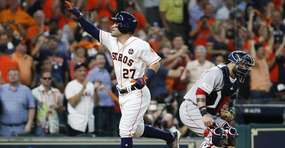PHOTOS: Astros 8, Red Sox 2Houston Astros second baseman Jose Altuve celebrates his third solo home run during the seventh inning of Game 1 of the ALDS at Minute Maid Park on Thursday, Oct. 5, 2017, in Houston. With home runs in the first, fifth and seventh innings, Altuve became just the 10th player in history to hit three home runs in a single post season game. ( Karen Warren / Houston Chronicle )Browse through the photos to see action from the Astros' win in Game 1 of the ALDS. Photo: Karen Warren/Houston Chronicle