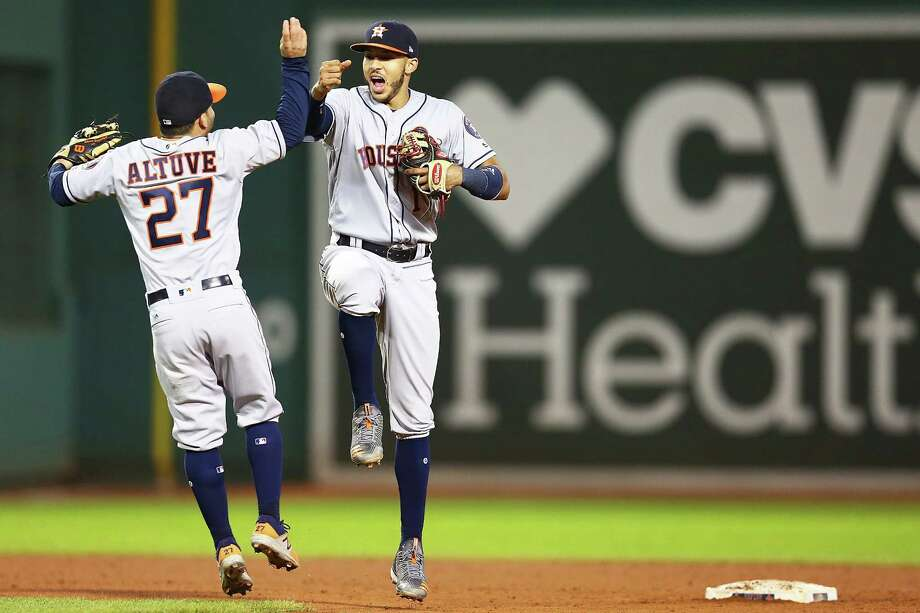 BOSTON, MA - SEPTEMBER 29:  Jose Altuve #27 and Carlos Correa #1 of the Houston Astros celebrate after a victory over the Boston Red Sox at Fenway Park on September 29, 2017 in Boston, Massachusetts.  (Photo by Adam Glanzman/Getty Images) Photo: Adam Glanzman, Stringer / 2017 Getty Images