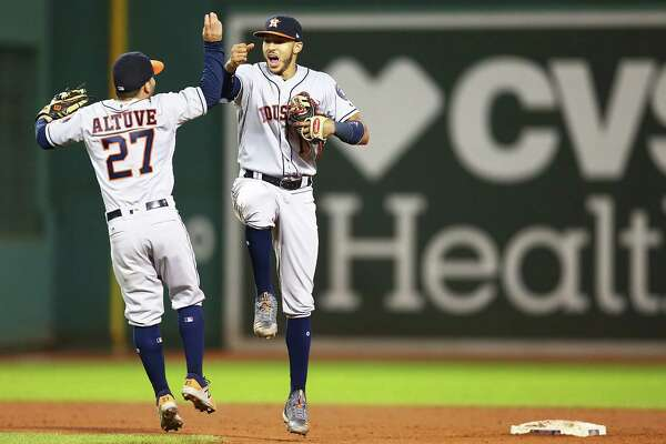BOSTON, MA - SEPTEMBER 29:  Jose Altuve #27 and Carlos Correa #1 of the Houston Astros celebrate after a victory over the Boston Red Sox at Fenway Park on September 29, 2017 in Boston, Massachusetts.  (Photo by Adam Glanzman/Getty Images)
