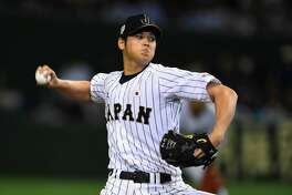 Starting pitcher Shohei Otani #16 of Japan throws in the top of fifth inning during the WBSC Premier 12 semi final match between South Korea and Japan at the Tokyo Dome on November 19, 2015 in Tokyo, Japan.  (Photo by Masterpress/Getty Images)