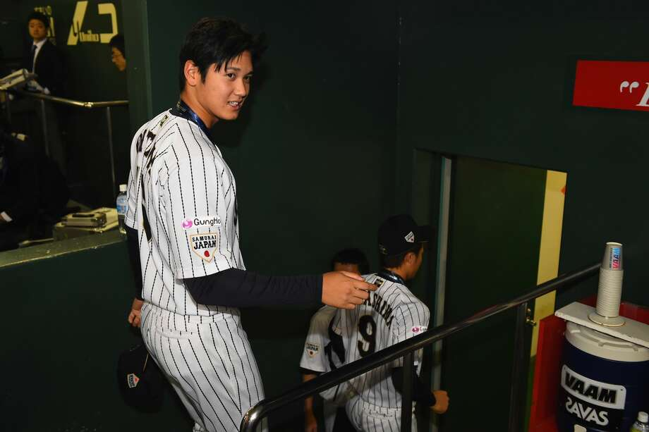 Shohei Otani #16 of Japan is seen in the bench after winning the WBSC Premier 12 third place play off match between Japan and Mexico at the Tokyo Dome on November 21, 2015 in Tokyo, Japan.  (Photo by Masterpress/Getty Images) Photo: Masterpress/Getty Images