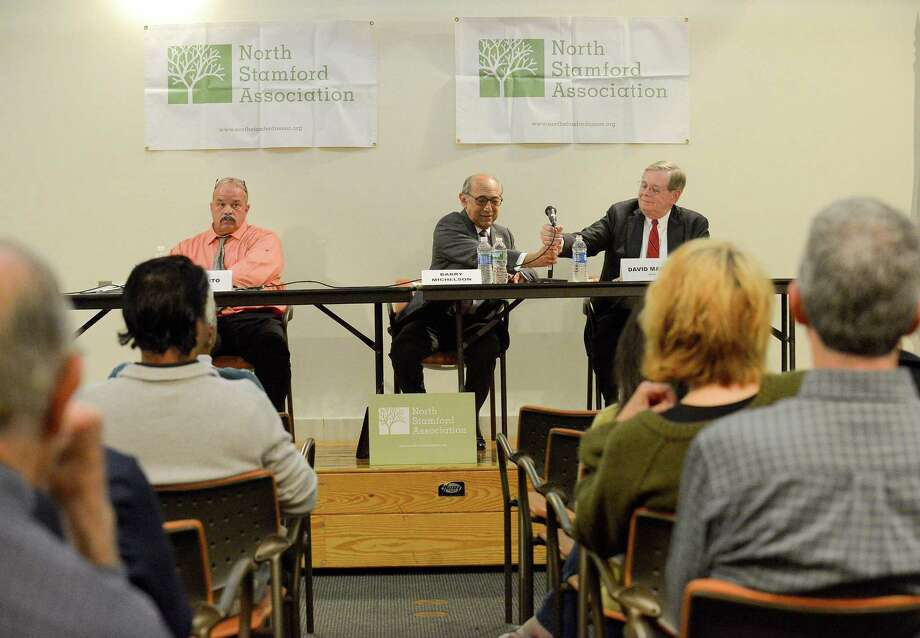 Unaffiliated candidate John Zito, at left, sits quietly as Republican challenger Barry Michelson hands over the microphone to Democratic incumbent David Martin during a forum for the three mayoral candidates at the Harry Bennett Library in Stamford, Connecticut  on Wednesday, Oct. 4,  2017. The event held by the North Stamford Association, allowed each candidate to answer questions from the residents attending the event. Photo: Matthew Brown / Hearst Connecticut Media / Stamford Advocate