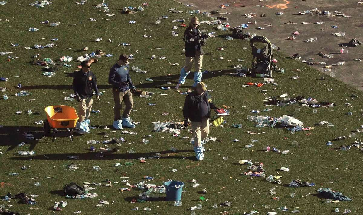 Investigators examine festival grounds across the street from the Mandalay Bay and Casino in Las Vegas on Tuesday.