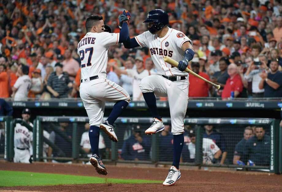 116766b95 Houston Astros  Jose Altuve (27) celebrates his solo home run against the  Boston