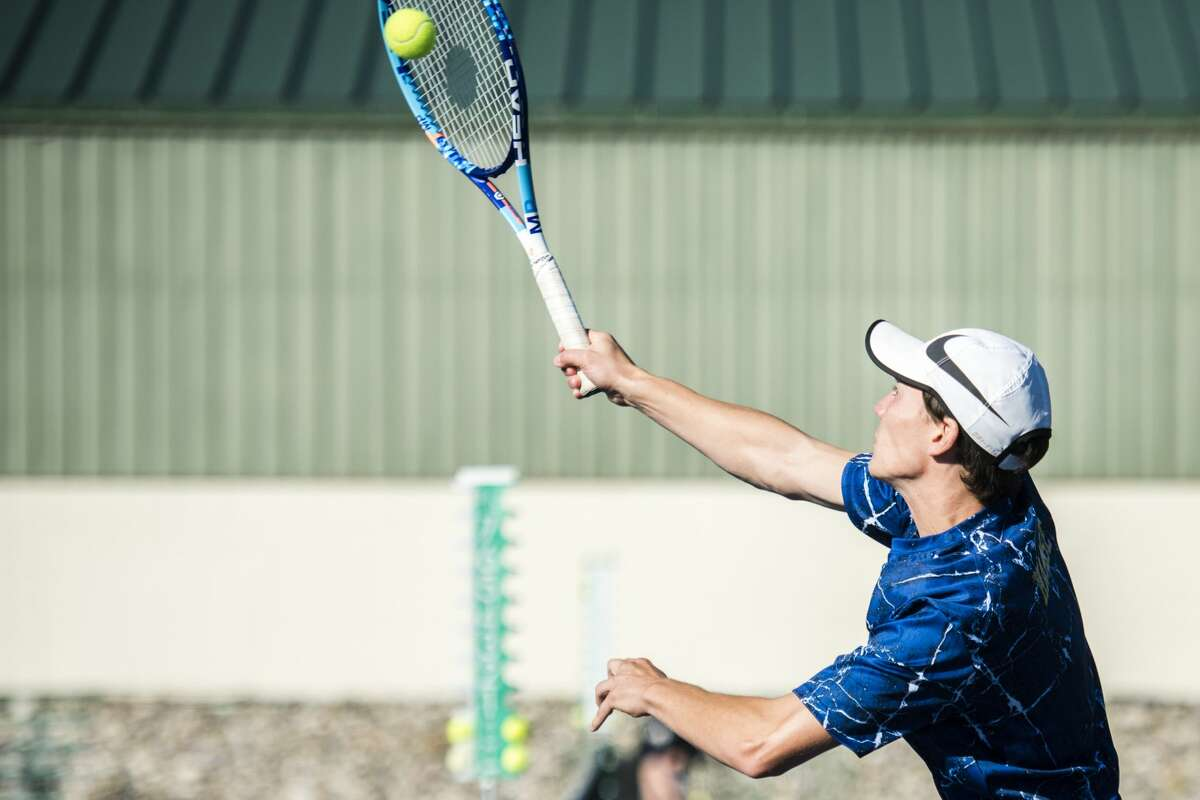 Senior Aidan Haase, half of Midland's number three doubles pair, volleys the ball during the Saginaw Valley Boys Tennis Tournament on Thursday, Oct. 5, 2017at the Greater Midland Tennis Center. (Danielle McGrew Tenbusch/for the Daily News)