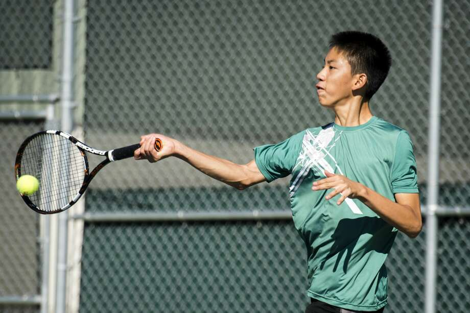 Freshman Caleb Qiu, Dow's number four singles player, returns the ball during the Saginaw Valley Boys Tennis Tournament on Thursday, Oct. 5, 2017 at the Greater Midland Tennis Center. (Danielle McGrew Tenbusch/for the Daily News) Photo: (Danielle McGrew Tenbusch/for The Daily News)