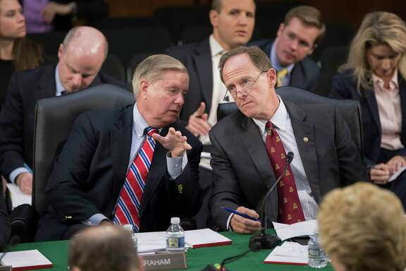Sen. Lindsey Graham, R-S.C., left, confers with Sen. Pat Toomey, R-Pa., as the Senate Budget Committee votes on amendments during the markup of Senate's fiscal year 2018 budget resolution, on Capitol Hill in Washington, Thursday, Oct. 5, 2017. (AP Photo/J. Scott Applewhite)