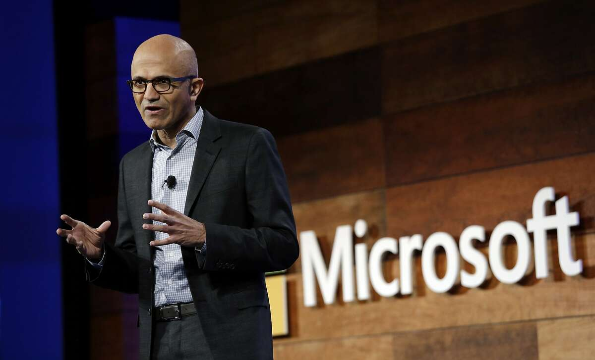 FILE - In this Wednesday, Nov. 30, 2016, file photo, Microsoft CEO Satya Nadella speaks at the annual Microsoft shareholders meeting, in Bellevue, Wash. Nadella has written an autobiography recounting his efforts to transform the technology company with a focus on empathy and changing its workplace culture. The book, �Hit Refresh,� also reveals some personal challenges, such as his risky move to switch his green card to a temporary work visa in the 1990s so that his wife could join him in the United States. (AP Photo/Elaine Thompson, File)