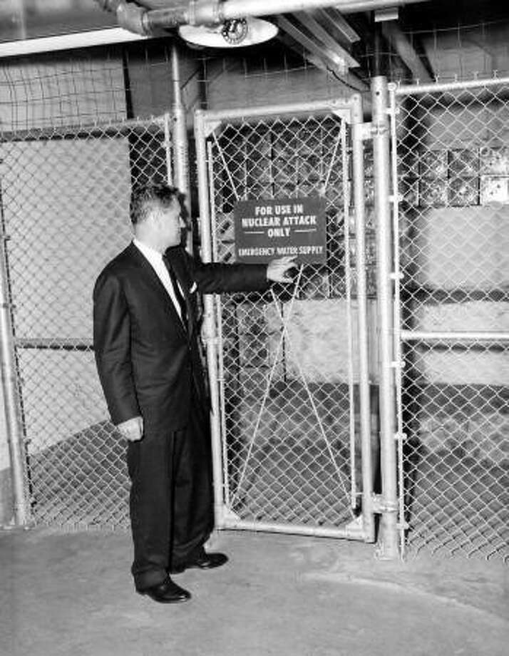 Gov. Nelson Rockefeller oversaw much of the state's early nuclear preparation. Here, he shows off a nuclear fallout shelter, including its 200 cots and 14,000 vitamin biscuits, in the basement of the state Capitol building in this undated photo taken in Albany, N.Y. Photo: (NYS Archives)