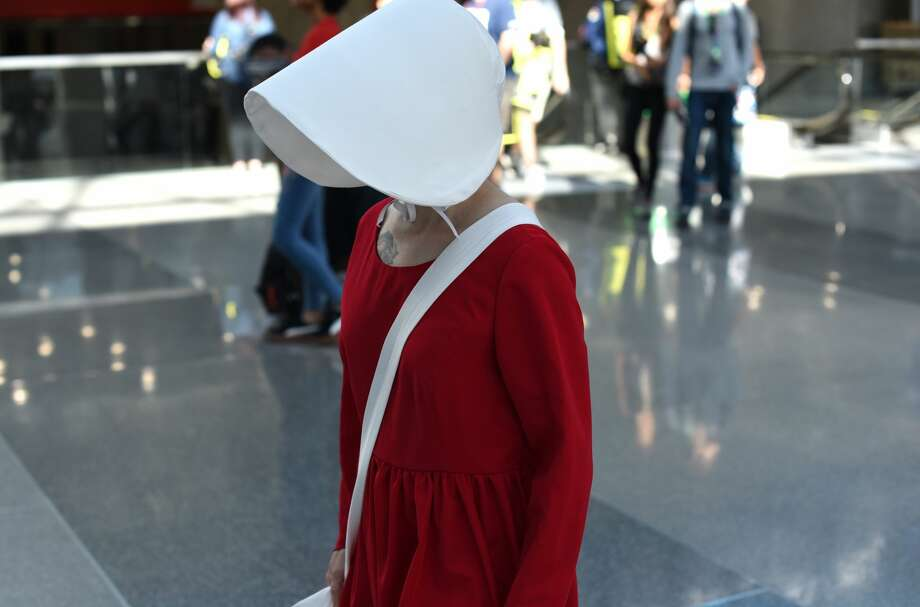 "New York Comic Con kicked off with a plethora of cosplayers dressed as their favorite characters. Among some of the new outfits was a handmaid from the 2017 show ""Handmaids Tale,"" which might just take the cake for this year's go-to pop culture costume. >> See other looks that people will probably be wearing this year. Photo: TIMOTHY A. CLARY/AFP/Getty Images"
