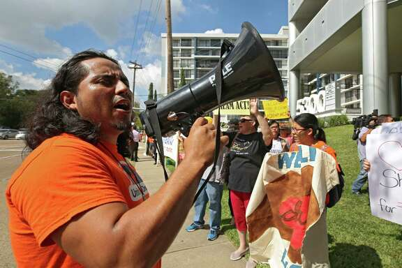 "Oscar Hernandez, with United We Dream Houston, leads protesters Thursday in a chant outside U.S. Sen. John Cornyn's Houston office to voice their support for legislation protecting ""Dreamers,"" young people who are in the country illegally."