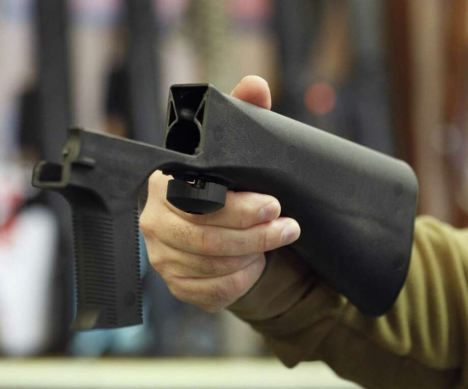 SALT LAKE CITY, UT - OCTOBER 5: A bump stock device that fits on a semi-automatic rifle to increase the firing speed, making it similar to a fully automatic rifle, is shown here at a gun store on October 5, 2017 in Salt Lake City, Utah. Congress is talking about banning this device after it was reported to of been used in the Las Vegas shootings on October 1, 2017.  (Photo by George Frey/Getty Images) Photo: George Frey, Stringer / Getty Images / 2017 Getty Images