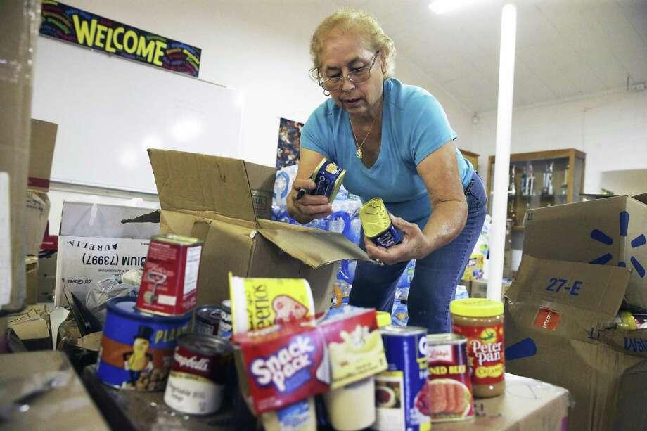 Irma Decker marks out scan codes as she packs boxes with canned ggods while parishioners at the Gethsemane Lutheran Church pack boxes of relief supplies on October 5, 2017 to be sent to Puerto Rico with church members who will be making a trip soon. Photo: Tom Reel, Staff / San Antonio Express-News / 2017 SAN ANTONIO EXPRESS-NEWS