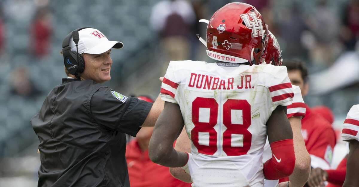 PHILADELPHIA, PA - SEPTEMBER 30: Head coach Major Applewhite of the Houston Cougars celebrates with Steven Dunbar #88 after a touchdown in the third quarter against the Temple Owls at Lincoln Financial Field on September 30, 2017 in Philadelphia, Pennsylvania. The Houston Cougars defeated the Temple Owls 20-13. (Photo by Mitchell Leff/Getty Images)