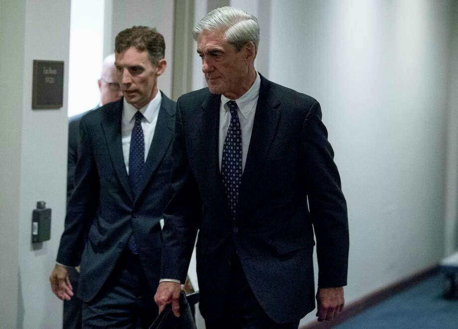 FILE - In this June 21, 2017, file photo, special counsel Robert Mueller departs Capitol Hill following a closed door meeting in Washington. Mueller's team of investigators has recently questioned a former British spy who compiled a dossier of allegations about President Donald Trump's ties to Russia. (AP Photo/Andrew Harnik) Photo: Andrew Harnik, STF / AP