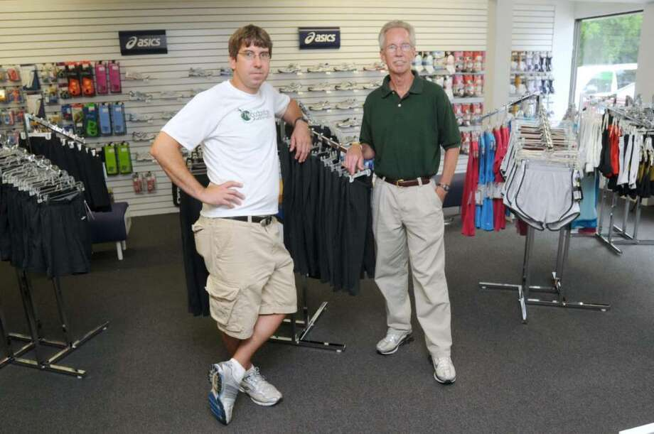 Chris Dickerson, left, owner of The Woodbridge Running Company - Brookfield, and store manager, Jack Coutts,  in the showroom of their newest store, located in Brookfield, on Thursday, June 24, 2010. The running supply store has two other locations,  Milford, CT and Northampton, MA. Photo: Jay Weir / The News-Times Freelance