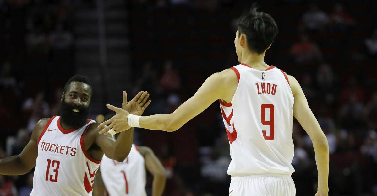 HOUSTON, TX - OCTOBER 05: James Harden #13 of Houston Rockets congratulates Zhou Qi #9 after scoring in the second quarter against the Shanghai Sharks at Toyota Center on October 5, 2017 in Houston, Texas. NOTE TO USER: User expressly acknowledges and agrees that, by downloading and or using this Photograph, user is consenting to the terms and conditions of the Getty Images License Agreement. (Photo by Tim Warner/Getty Images)