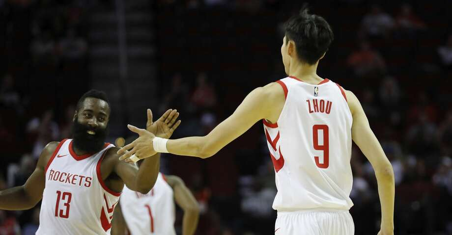 PHOTOS: Rockets 144, Sharks 82HOUSTON, TX - OCTOBER 05:  James Harden #13 of Houston Rockets congratulates Zhou Qi #9 after scoring in the second quarter against the Shanghai Sharks at Toyota Center on October 5, 2017 in Houston, Texas.  NOTE TO USER: User expressly acknowledges and agrees that, by downloading and or using this Photograph, user is consenting to the terms and conditions of the Getty Images License Agreement.  (Photo by Tim Warner/Getty Images)Browse through the photos to see action from the Rockets' exhibition win on Thursday. Photo: Tim Warner/Getty Images