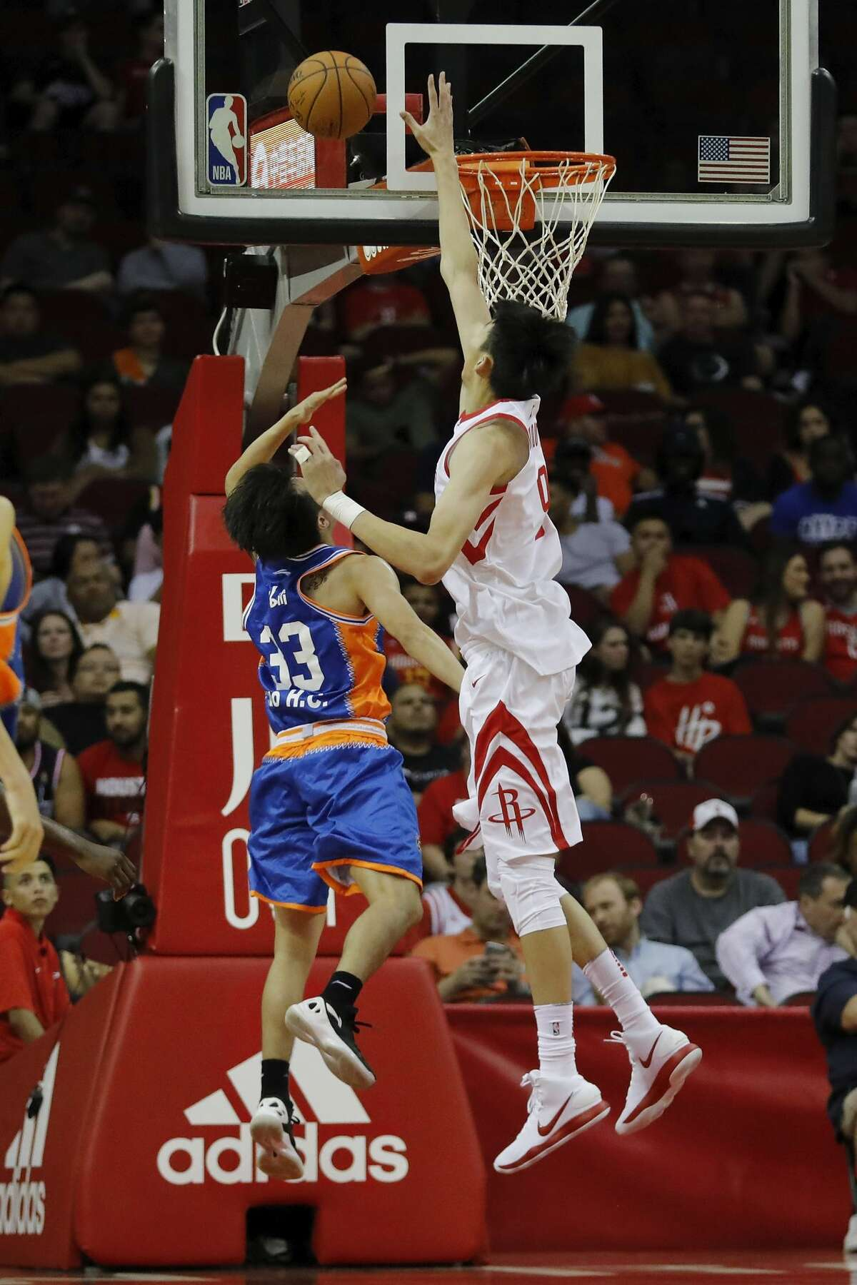 HOUSTON, TX - OCTOBER 05: Zhou Qi #9 of Houston Rockets defends the shot by Luo Hanchen #33 of Shanghai Sharks in the second quarter at Toyota Center on October 5, 2017 in Houston, Texas. NOTE TO USER: User expressly acknowledges and agrees that, by downloading and or using this Photograph, user is consenting to the terms and conditions of the Getty Images License Agreement. (Photo by Tim Warner/Getty Images)