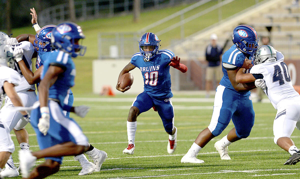 West Brook's Bralin Adams looks to evade College Park's defense as he carries the ball during Thursday's homecoming game. Photo taken Thursday, October 5, 2017 Kim Brent/The Enterprise