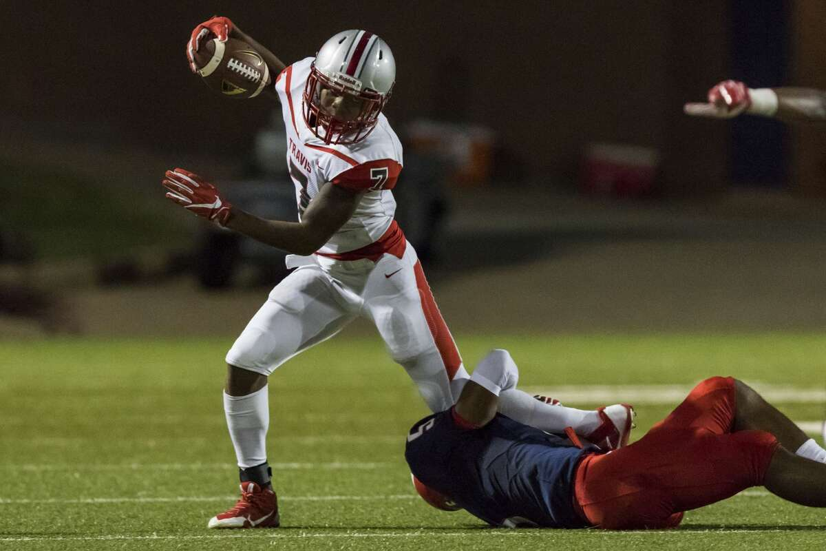 Travis running back Naveon Mitchell (7) is tackled at the line of scrimmage by Dulles defensive back Myles Heard (5) in a high school football game at Mercer Stadium on Thursday, Oct. 5, 2017, in Sugarland, Texas. (Joe Buvid / For the Houston Chronicle)