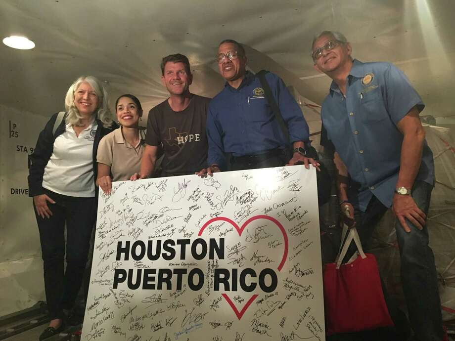 Houston volunteers and city officials pose in San Juan's Luis Munoz Marin International Airport on Thursday, Oct. 5, 2017.See more images from the devastation by Hurricane Maria Photo: Lindsay Ellis/Houston Chronicle / Houston Chronicle