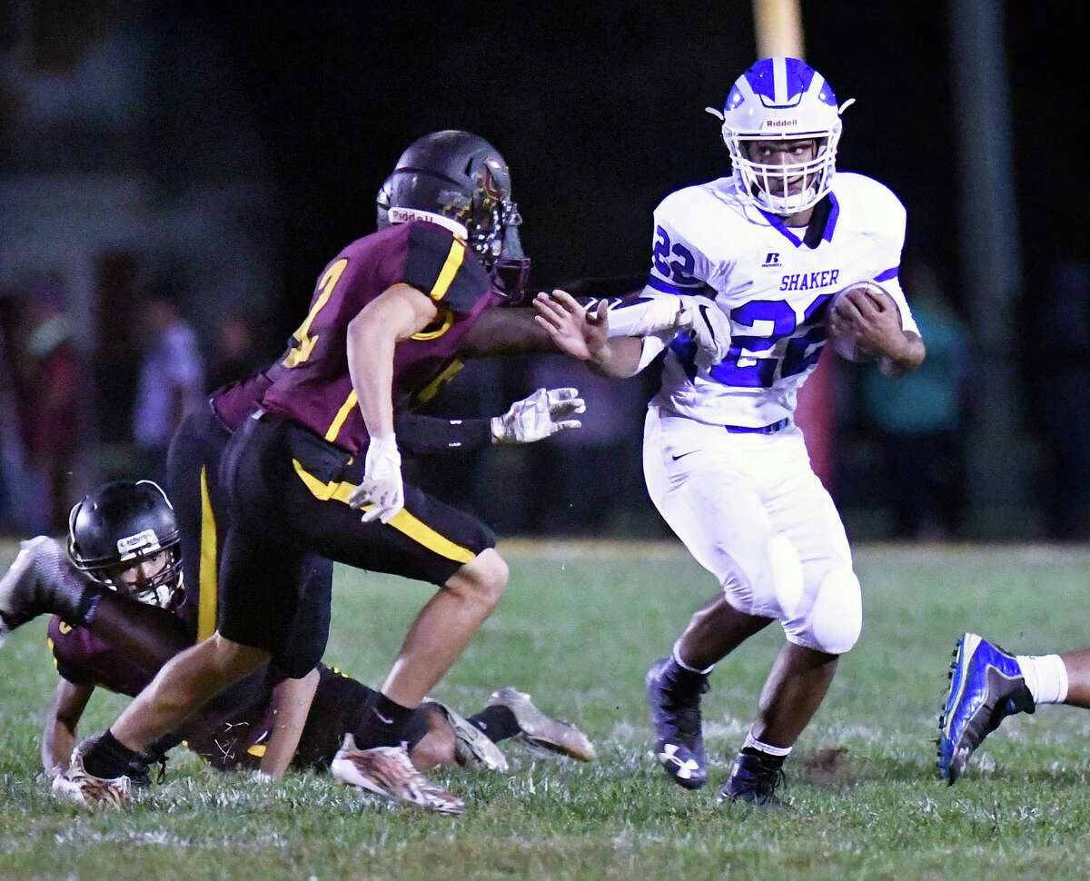 Shaker's Ravion Burt (22) runs the ball past Colonie's Dylan Williams (2) during a Section II Class AA high school football game in Colonie, N.Y., Thursday, Sept. 28, 2017. (Hans Pennink / Special to the Times Union) ORG XMIT: HP124