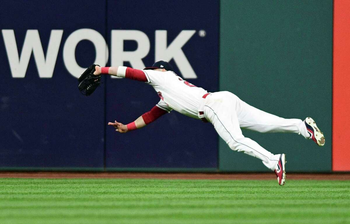 Cleveland Indians' Jason Kipnis catches a fly ball hit by New York Yankees' Chase Headley during the third inning of Game 1 of a baseball American League Division Series, Thursday, Oct. 5, 2017, in Cleveland.