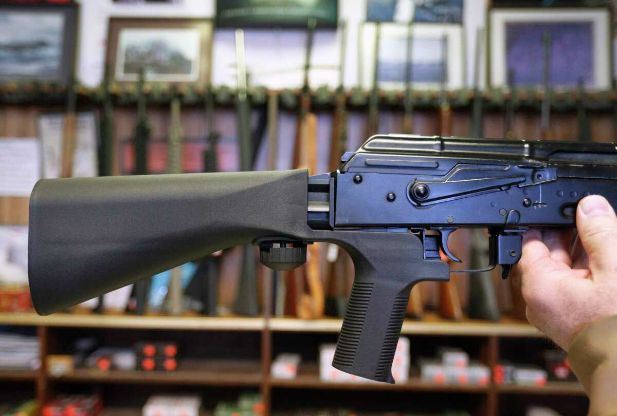 SALT LAKE CITY, UT - OCTOBER 5: A bump stock device (left) that fits on a semi-automatic rifle to increase the firing speed, making it similar to a fully automatic rifle, is installed on a AK-47 semi-automatic rifle, (right) at a gun store on October 5, 2017 in Salt Lake City, Utah. Congress is talking about banning this device after it was reported to of been used in the Las Vegas shootings on October 1, 2017. (Photo by George Frey/Getty Images) *** BESTPIX *** ORG XMIT: 775055031