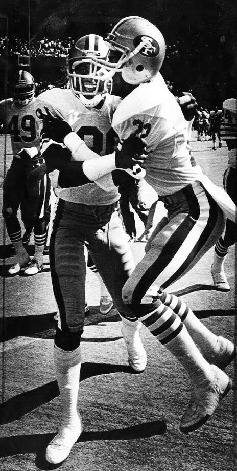 Jerry Rice and Tim McKyer celebrate after Rice's touchdown catch as time expired against the Cincinnati Bengals September 20, 1987  Photo ran 09/21/1987, D3 Photo: Michael Maloney, San Francisco Chronicle