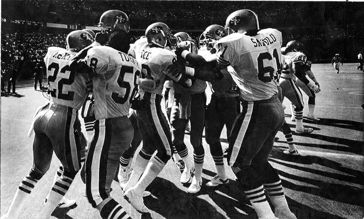 Teammates mob Jerry Rice after his touchdown catch as time expired against the Cincinnati Bengals September 20, 1987 Photo ran 09/21/1987, D1