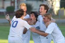 Blue Streak teammates celebrate with Aidan Rice, 2nd from right, after Rice's 2nd goal of the game game Saraoga a 2-1 win over Shen during Suburban Council boys soccer action at Saratoga Springs High School Thursday, Oct. 5, 2017. (Ed Burke photo/Special to The Times Union)
