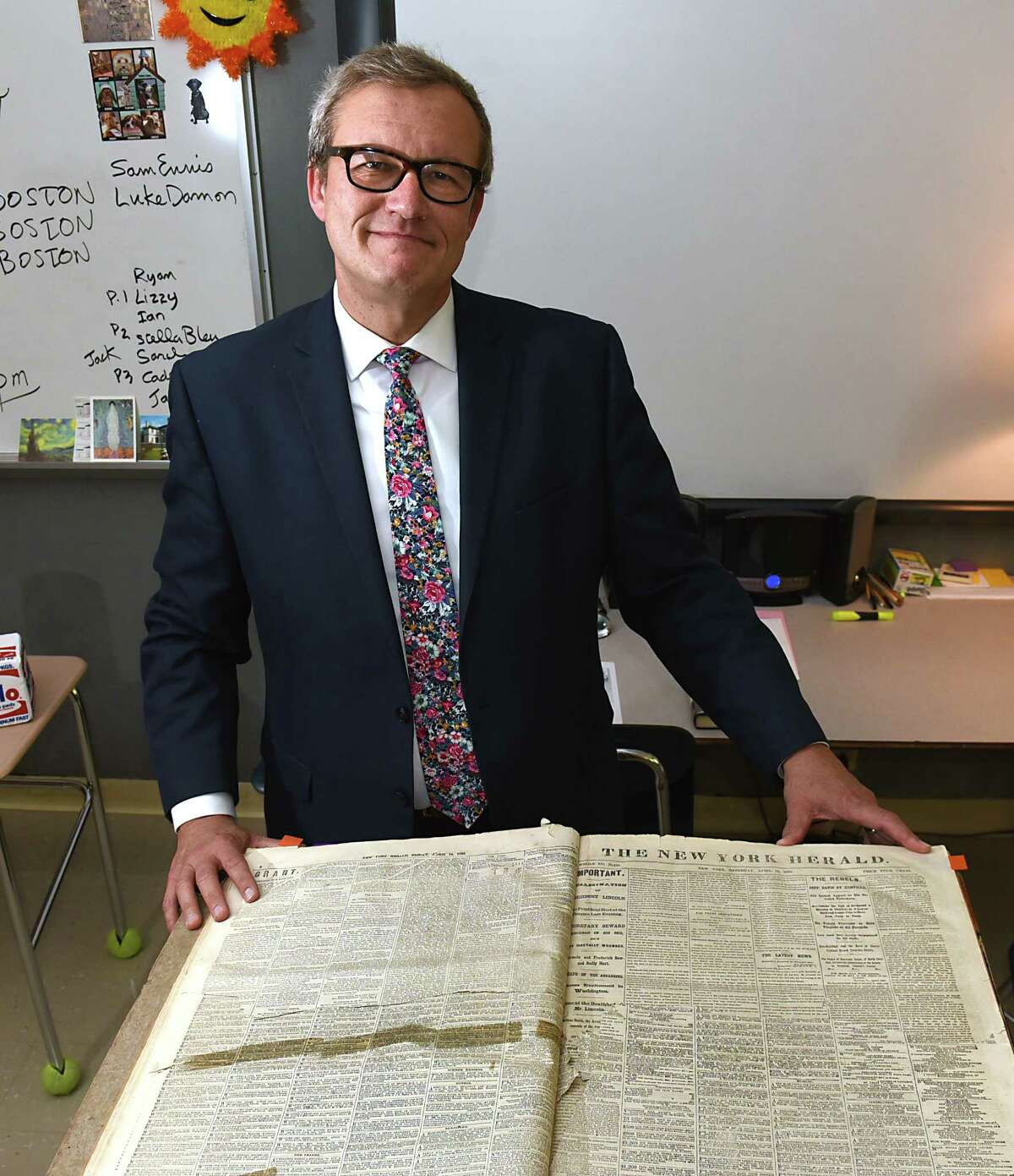 Iroquois Middle School teacher Michael Jesep stands with copies of the New York Herald from the 1860s in his classroom on Wednesday, Oct. 4, 2017 in Schenectady, N.Y. Jesep teaches 8th grade Social Studies and English. (Lori Van Buren / Times Union)