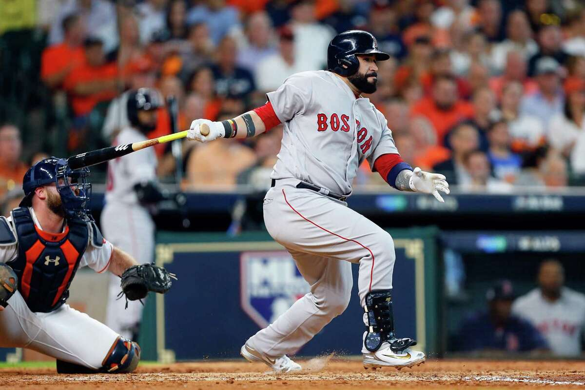 HOUSTON, TX - OCTOBER 05: Sandy Leon #3 of the Boston Red Sox hits a single in the fourth inning against the Houston Astros during game one of the American League Division Series at Minute Maid Park on October 5, 2017 in Houston, Texas. (Photo by Bob Levey/Getty Images) ORG XMIT: 775053700