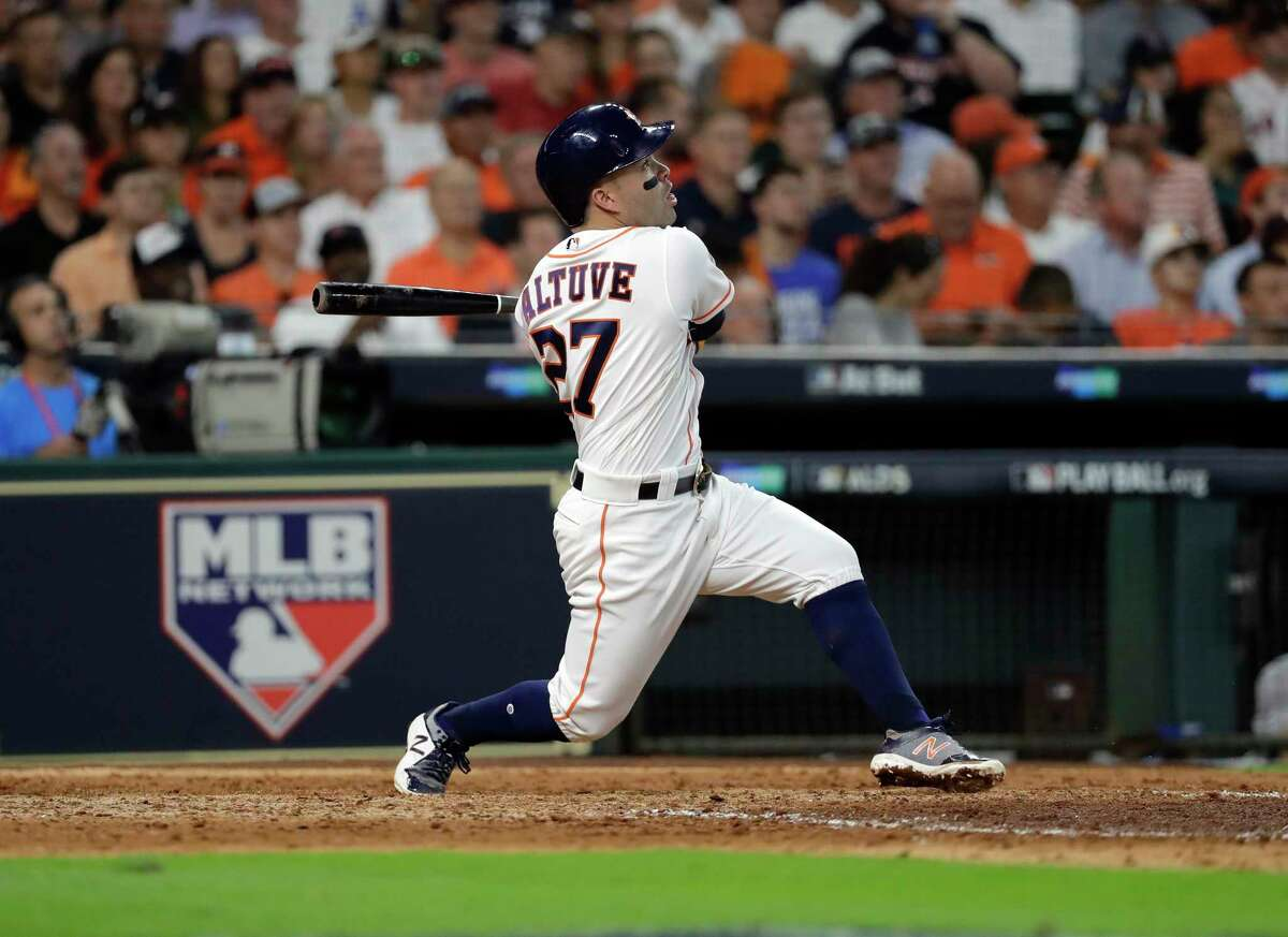 Houston Astros' Jose Altuve watches his a solo home run, his third of the game, against the Boston Red Sox in the seventh inning in Game 1 of baseball's American League Division Series, Thursday, Oct. 5, 2017, in Houston. (AP Photo/David J. Phillip) ORG XMIT: OTK