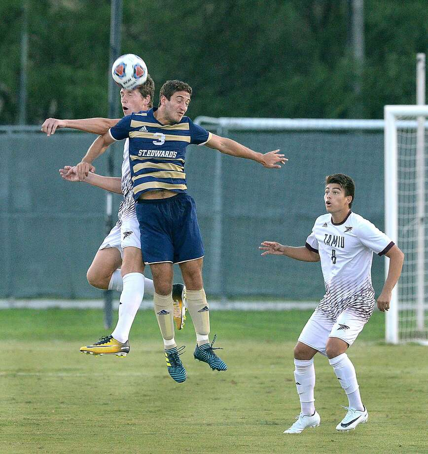 Dustdevils forward Rafael Montabes and Ruben Gonzalez, of St. Edward's University, go for a header in their match, Thursday, October 5, 2017, at TAMIU Soccer Field. David Martinez follows the action. Photo: Cuate Santos /Laredo Morning Times File / Laredo Morning Times