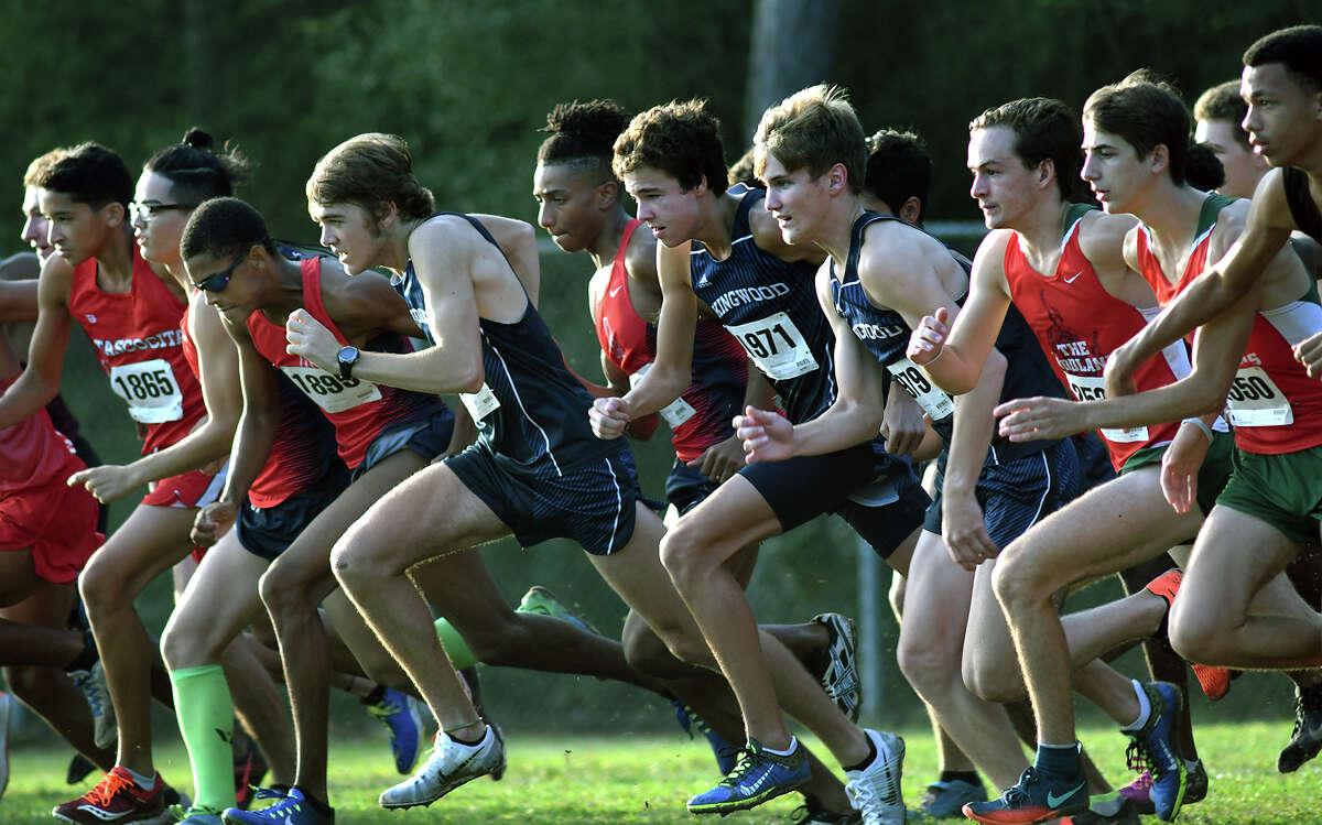 Atascocita's Worthington Moore (in sunglasses) and Kingwood's Carter Storm lead their teams off the starting line in the Varsity Boys 5K race at the Andy Wells Invitational at Atascocita High School on Sept. 16, 2017. (Photo by Jerry Baker)
