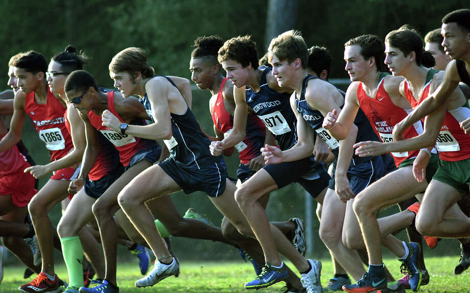 Atascocita's Worthington Moore (in sunglasses) and Kingwood's Carter Storm lead their teams off the starting line in the Varsity Boys 5K race at the Andy Wells Invitational at Atascocita High School on Sept. 16, 2017. (Photo by Jerry Baker) Photo: Jerry Baker, Freelance / Freelance