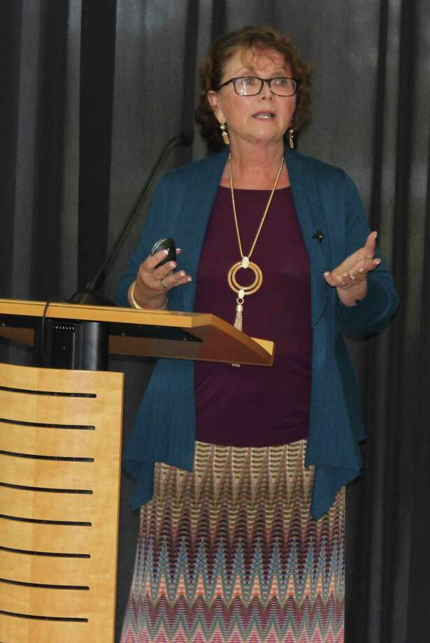 Guest speaker and authorLorraine Grubbs discusses business practices that help make the workplace a happy and positive environment during the Greater East Montgomery County Chamber luncheon on Oct. 4. Photo: Jacob McAdams