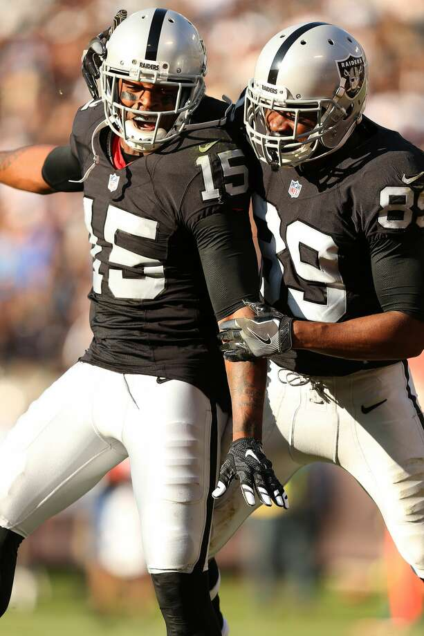 Oakland Raiders wide receivers Michael Crabtree (15) and Amari Cooper (89) celebrate a touchdown during an NFL football game against the Tennessee Titans Saturday, Aug. 27, 2016, in Oakland, CA. The Titans beat the Raiders 27-14. (Daniel Gluskoter/AP Images for Panini) Photo: Daniel Gluskoter/Associated Press